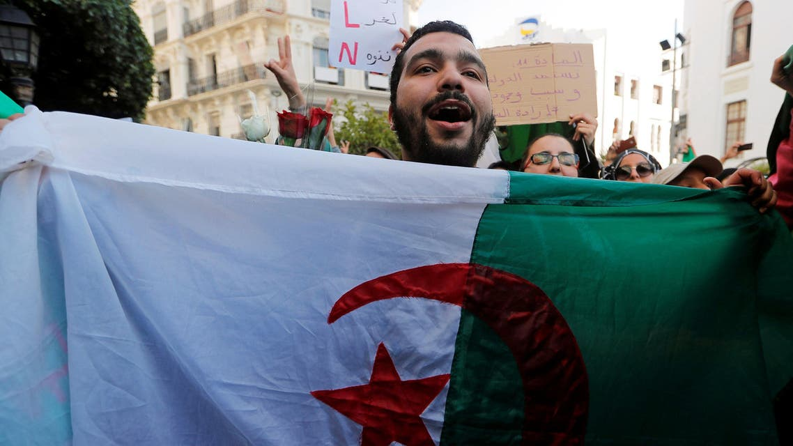 """Students take part in a protest to denounce an offer by President Abdelaziz Bouteflika to run in elections next month but not to serve a full term if re-elected, in Algiers, Algeria March 5, 2019. The sign reads: """"State legitimacy comes from people's will"""". REUTERS/Zohra Bensemra"""