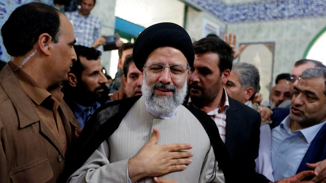 Iranian presidential candidate Ebrahim Raisi leaves after casting his ballot for the presidential elections at a polling station in southern Tehran on May 19, 2017.