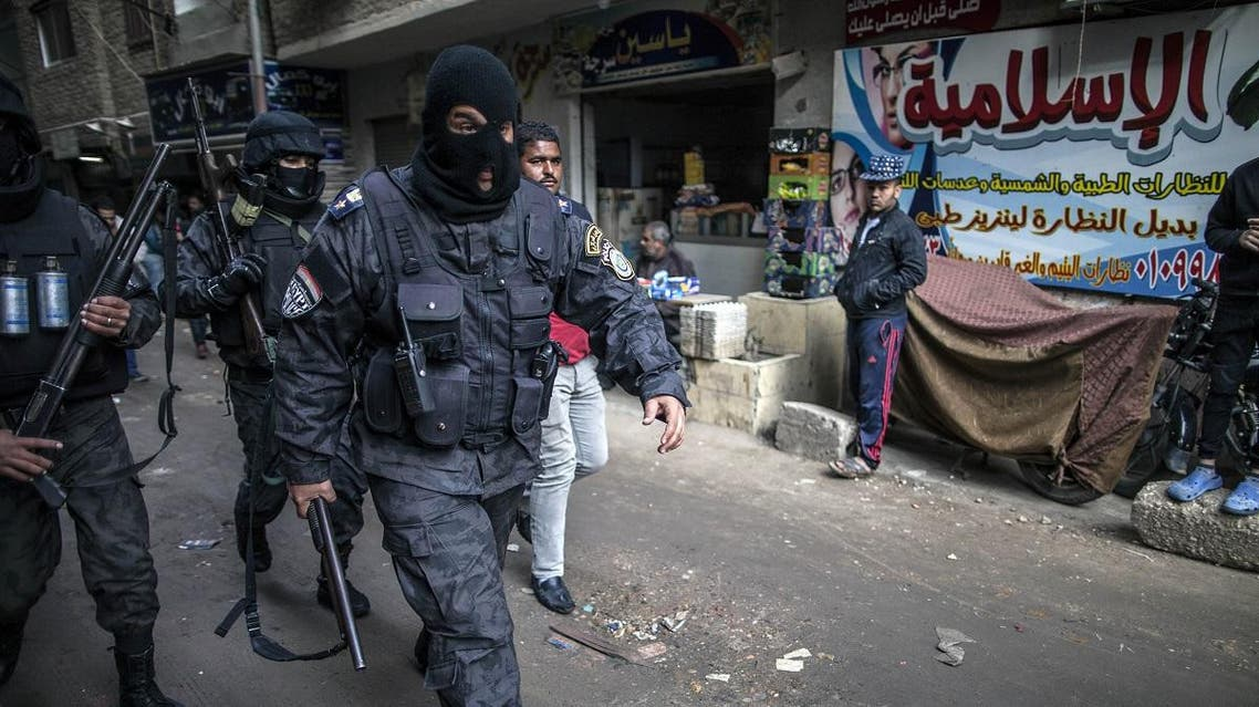 Members of the Egyptian police special forces patrol streets in al-Haram neighbourhood in the southern Cairo Giza district. (AFP)