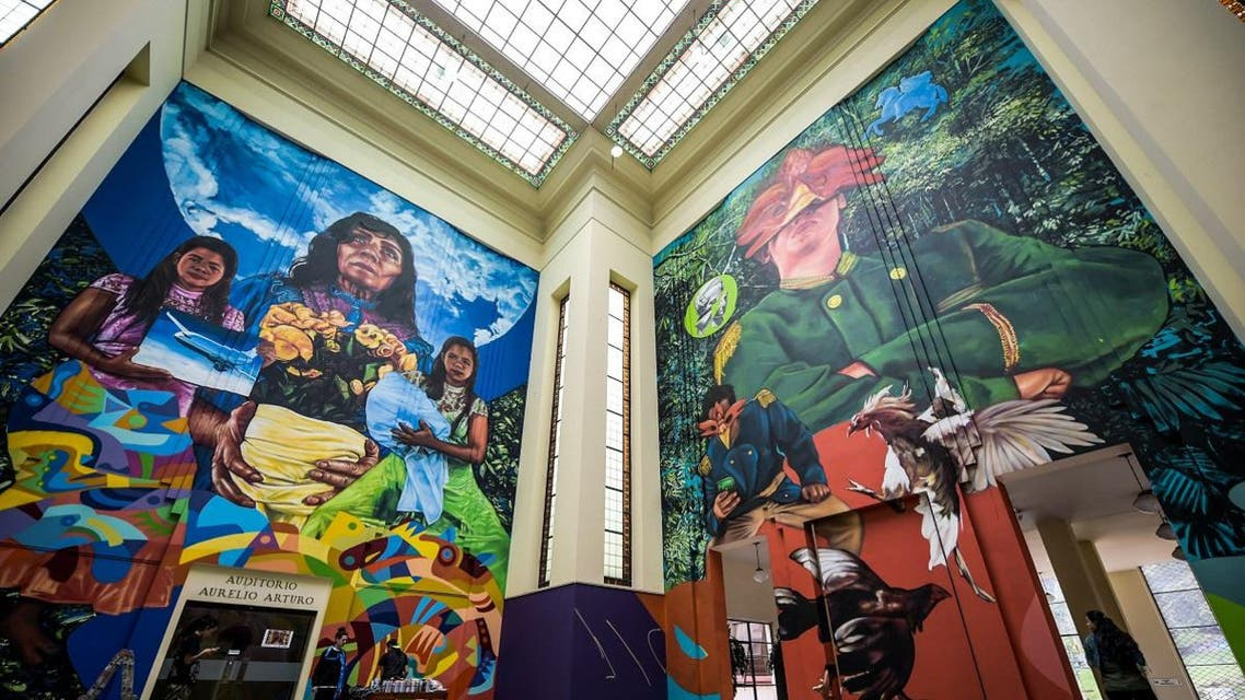 """Partial view of a mural painting by Colombian artist Oscar Gonzalez """"Guache"""" and US Andrew Pisacane """"Gaia"""" representing passages from One hundred years of solitude) by Nobel Literature laureate, the late Gabriel Garcia Marquez. (AFP)"""