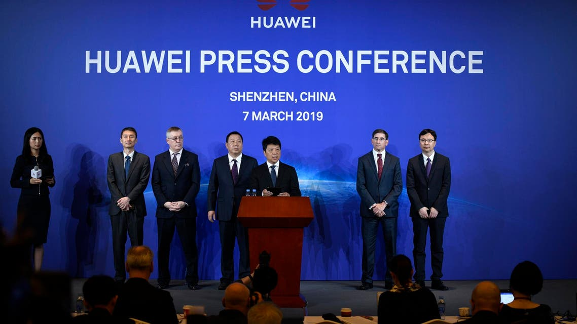 Huawei's rotating chairman Guo Ping (C) speaks during a press conference in Shenzhen, on March 7, 2019. (AFP)