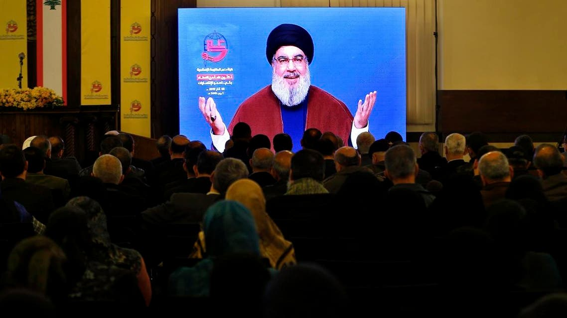 Supporters of the Iranian-backed Hezbollah group listen to a speech of leader Sayyed Hassan Nasrallah, via a video link, in a southern suburb of Beirut, Lebanon, on March 8, 2019. (AP)