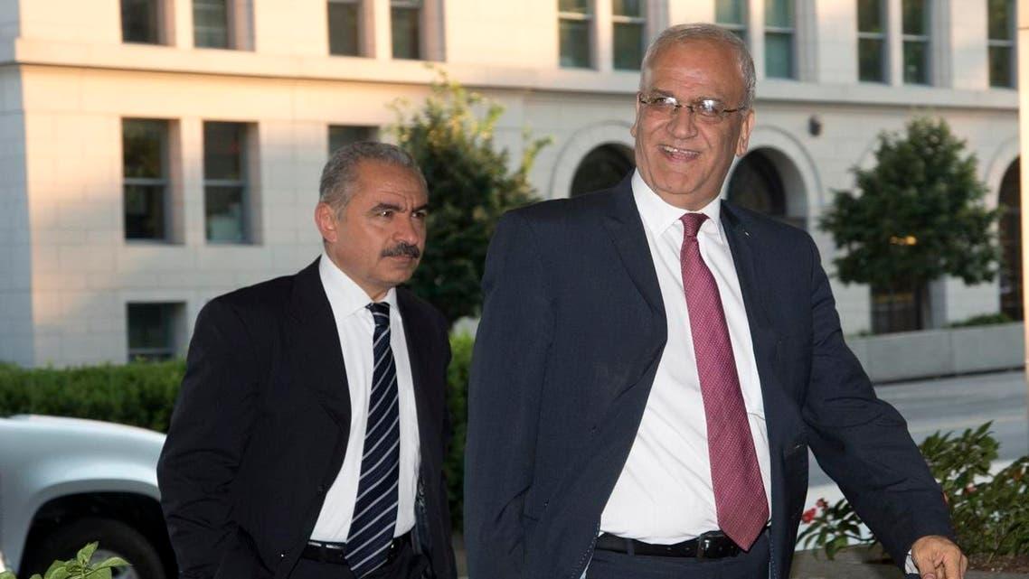 Saeb Erekat, right, Palestinian chief negotiator and Mohammad I. Shtayyeh (AP)