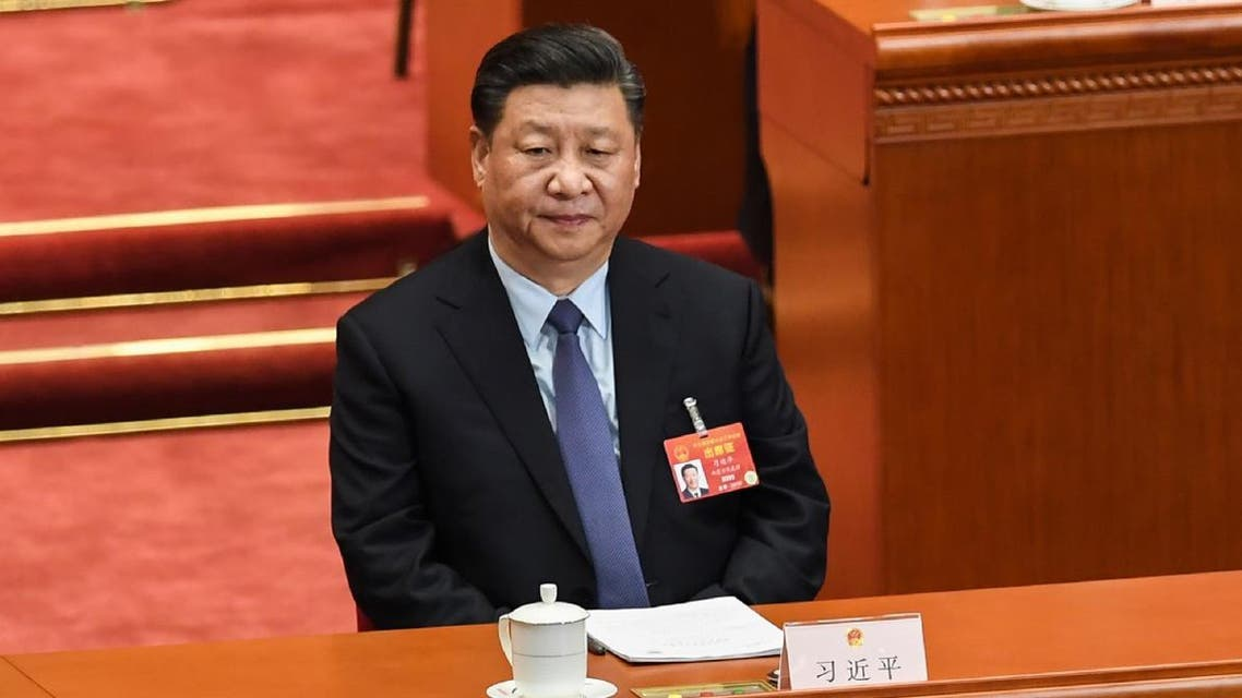 China's President Xi Jinping attends the second plenary session of the National People's Congress (NPC) at the Great Hall of the People in Beijing on March 8, 2019. (AFP)