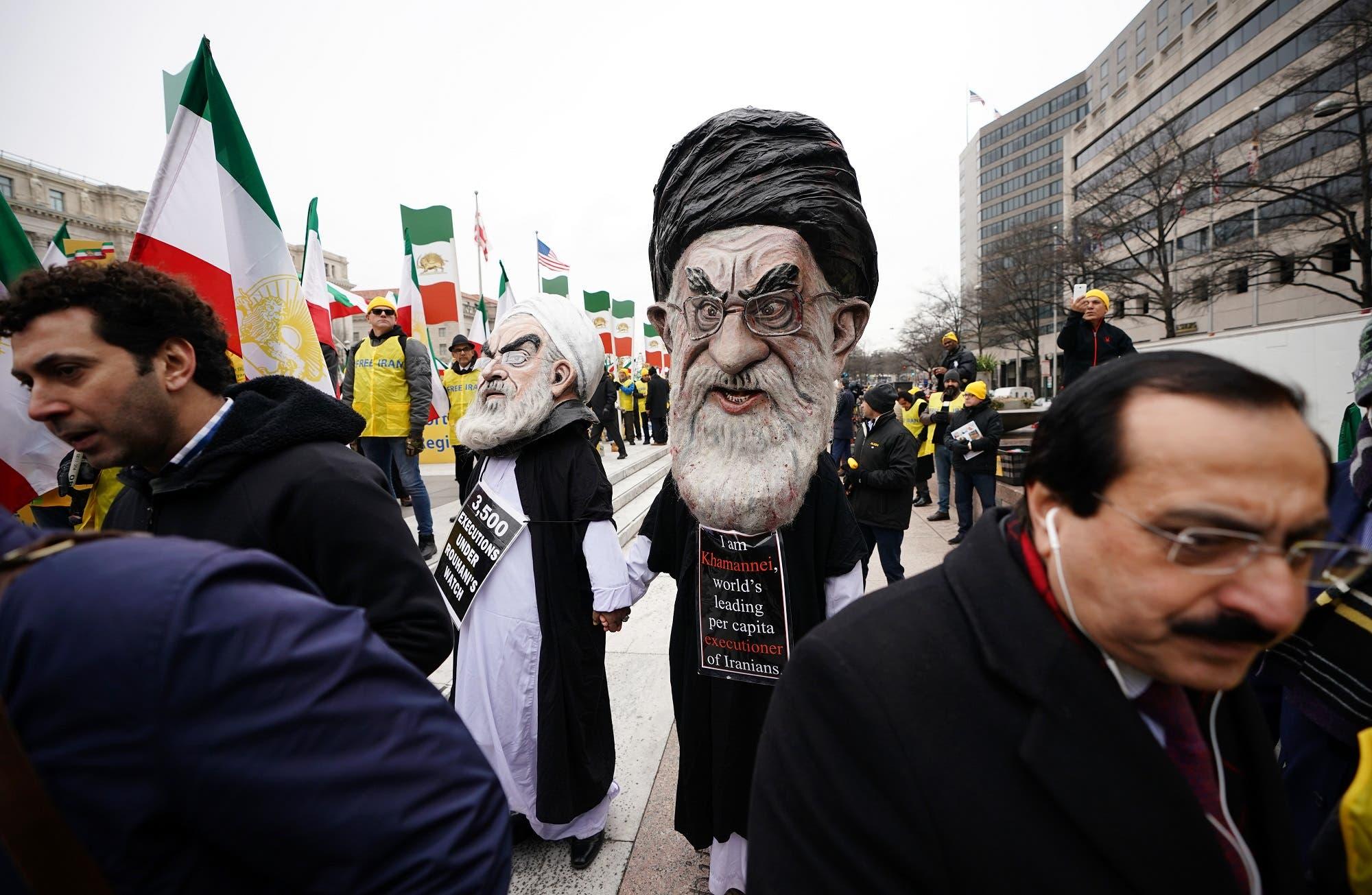 Effigies of Iranian President Hassan Rouhani and Iran's supreme leader Ayatollah Ali Khamenei march with the Organization of Iranian-American Communities on March 8, 2019 in Washington, DC. (AFP)