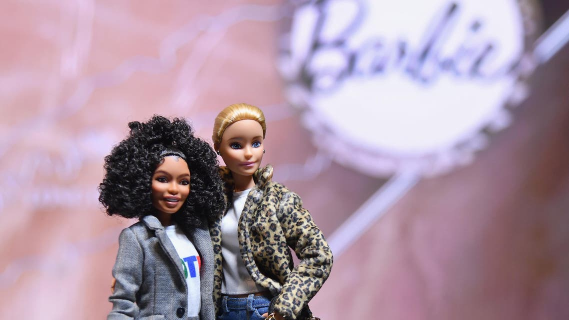 Barbie Dolls are seen in celebration of Barbie's 60th Anniversary and International Women's Day at the Empire State Building on March 8, 2019 in New York City. (AFP)