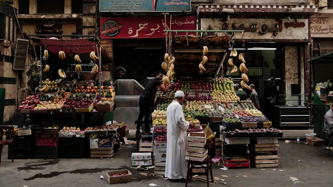 A fruit vendor waits for customers in Tawfiqia market in downtown Cairo, Egypt. (File photo: AP)