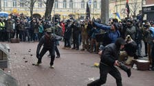 Tens of police hospitalized after Ukraine clashes ahead of poll