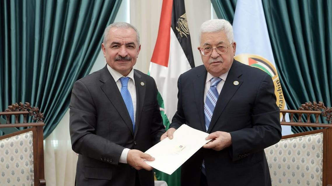 Senior Fatah official Mohammad Shtayyeh receives a designation letter from Palestinian President Mahmoud Abbas to form a new Palestinian government. (Reuters)