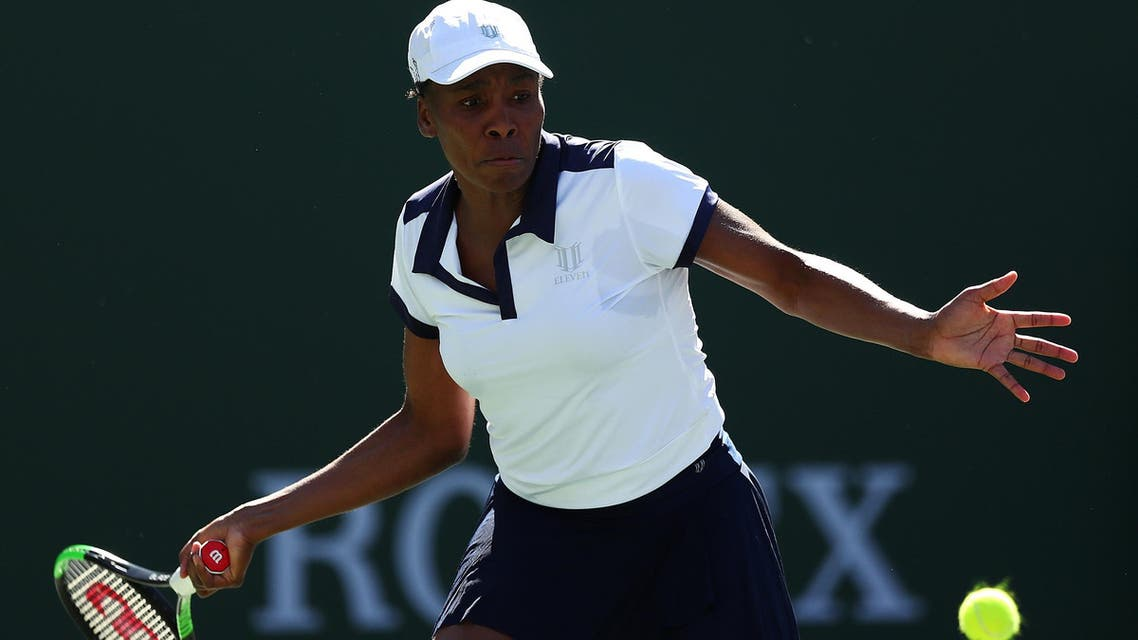 Venus Williams plays a forehand against Andrea Petkovic of Germany during their match in Indian Wells on March 07, 2019. (AFP)