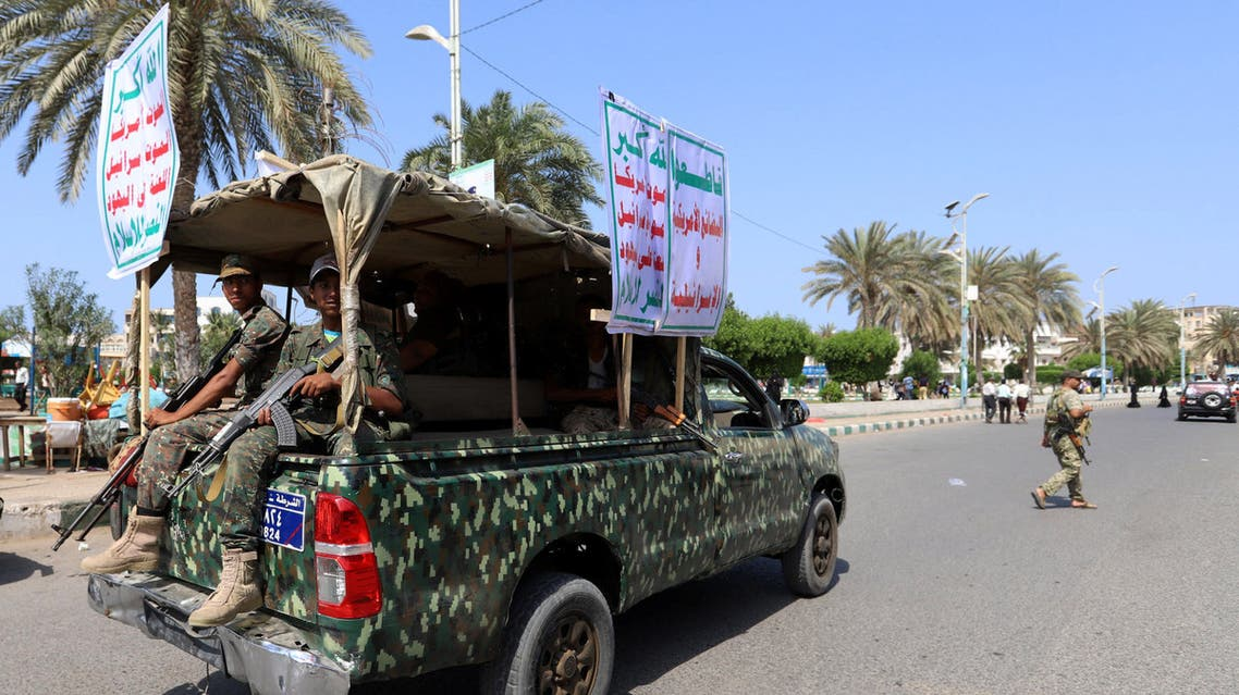 Houthi militants ride on the back of a police patrol truck as they secure a street where Houthi supporters demonstrated against British Foreign Secretary Jeremy Hunt in Hodeidah, Yemen March 5, 2019. The placards read: Allah is the greatest .. death to America .. death to Israel .. a curse on Jews .. victory to Islam. and Boycott the American and Israeli goods!. REUTERS/Abduljabbar Zeyad