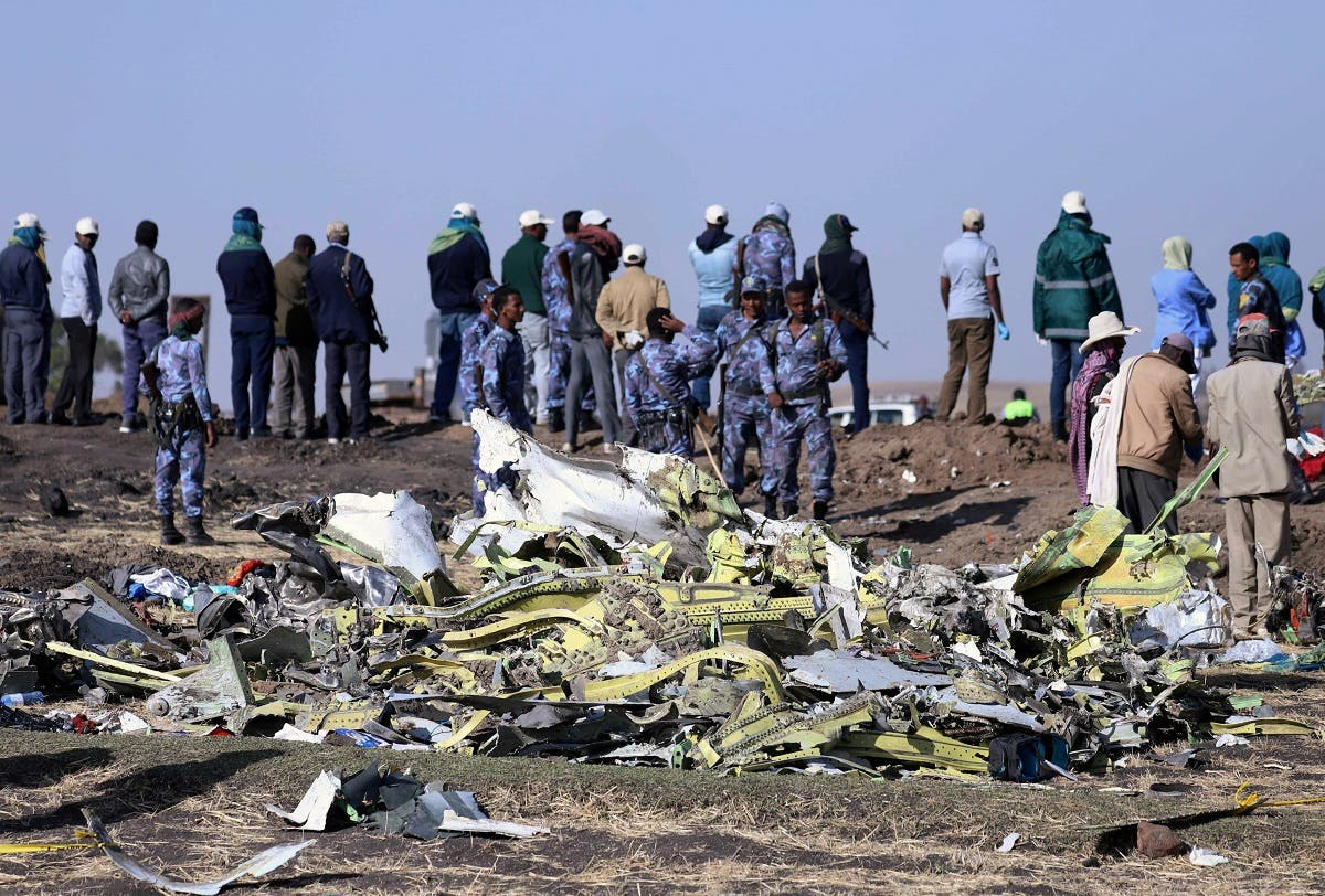 Ethiopian Federal policemen stand at the scene of the Ethiopian Airlines Flight ET 302 plane crash, near the town of Bishoftu. (Reuters)