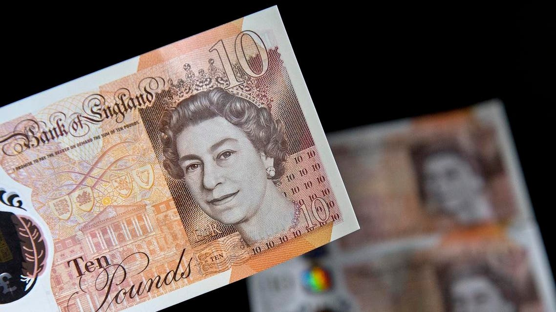 British ten pound sterling notes are arranged for a photograph in London on December 14, 2017.  Justin TALLIS / AFP