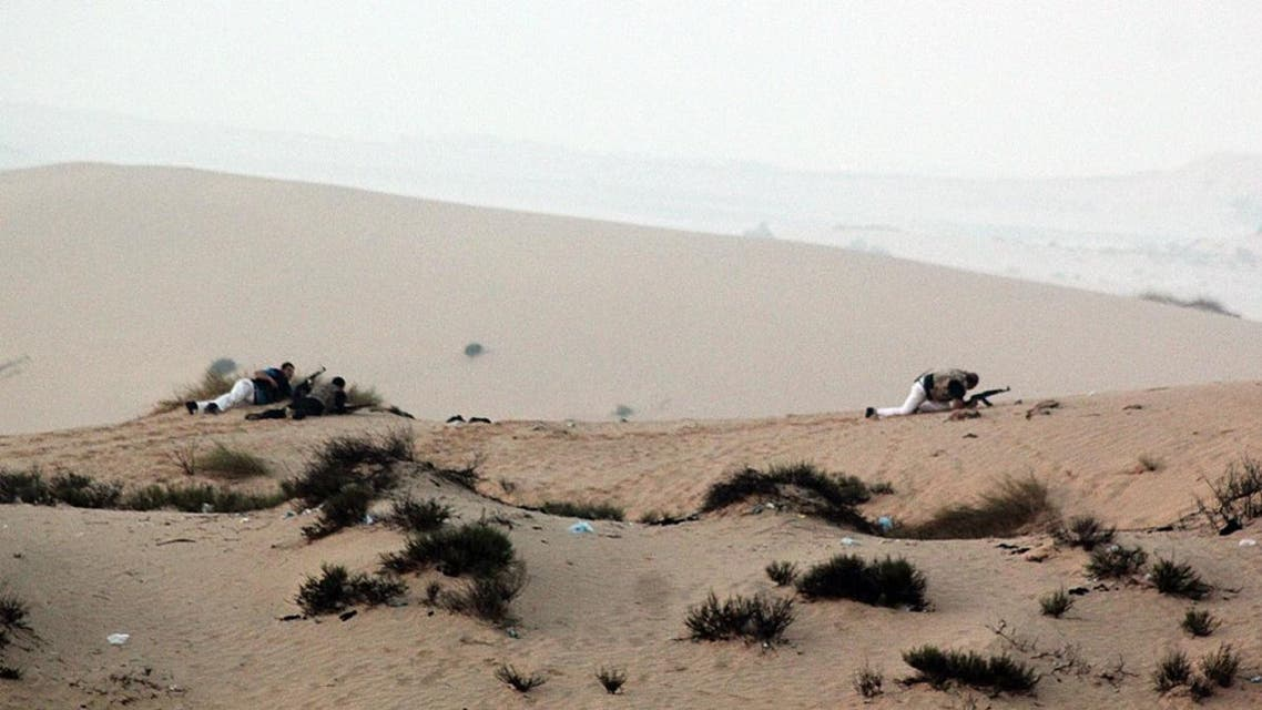Members of the Egyptian security forces take position on a sand dune during an operation in the northern Sinai peninsula. (AFP)
