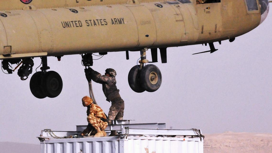 "In this photo provided by ISAF Regional Command (South), soldiers from Combined Team Zabul sling-load a container of components for a cell phone tower, on March 25, 2011, at Forward Operating Base Lagman, in the Kandahar province of Afghanistan. The components are being airlifted to the village of Nawbahar.AFP PHOTO/ US Army Sgt. Jerry Wilson/HANDOUT/RESTRICTED TO EDITORIAL USE - MANDATORY CREDIT "" AFP PHOTO / - NO MARKETING NO ADVERTISING CAMPAIGNS - DISTRIBUTED AS A SERVICE TO CLIENTS"