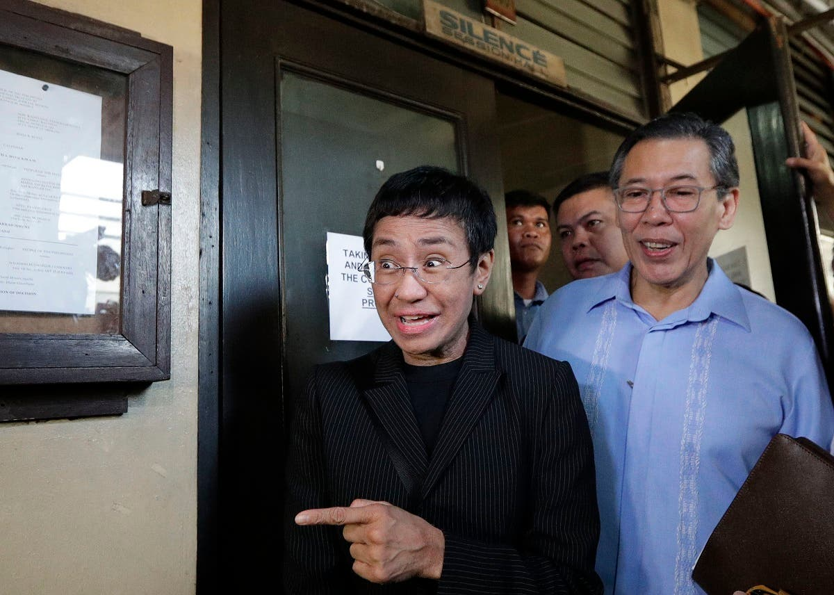 Maria Ressa, head of the Philippine online news site Rappler, gestures as she walks outside the Regional Trial Court branch 46 in Manila, Philippines on Friday, March 1, 2019. (AP)