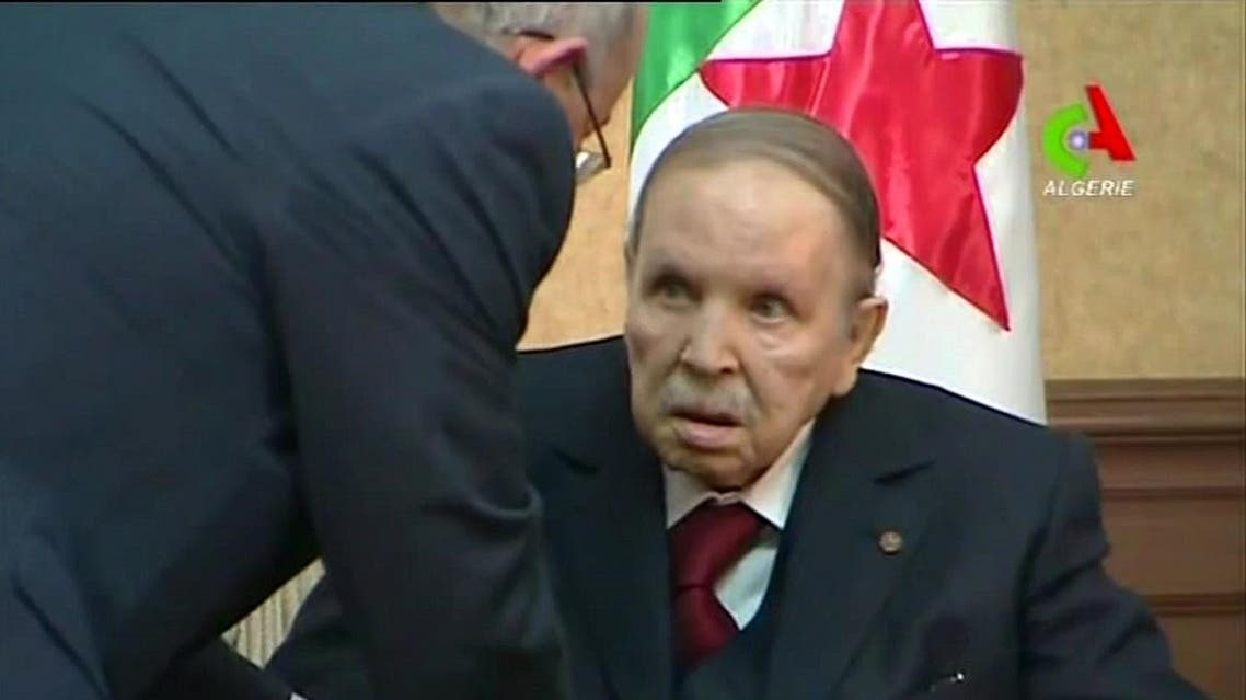 "A video grab taken from footage broadcast by Algeria's ""Canal Algerie"" on March 11, 2019 shows Algerian President Abdelaziz Bouteflika meeting with members of his government in the capital Algiers. (AFP)"