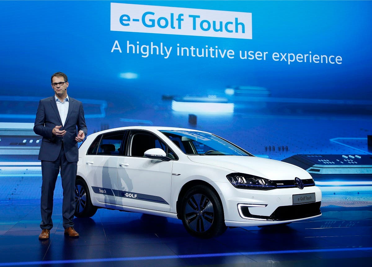 Volkmar Tanneberger, head of electric and electronic development at Volkswagen, talks about the e-Golf Touch electric car during a keynote address at CES International. (File photo: AP)