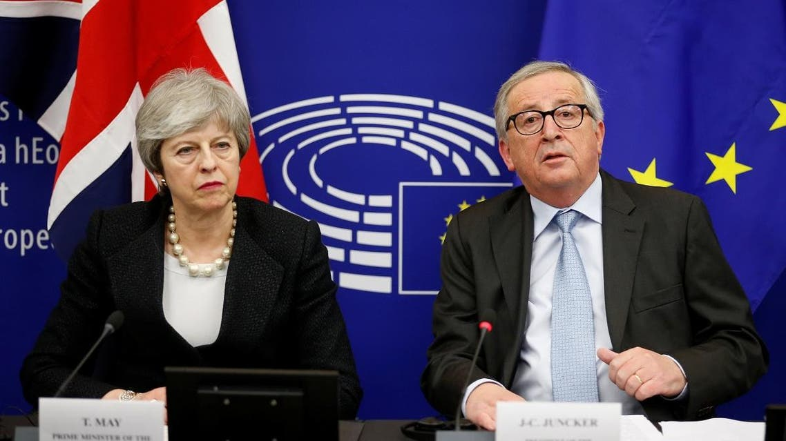 British Prime Minister Theresa May and European Commission President Jean-Claude Juncker attend a news conference in Strasbourg. (Reuters)