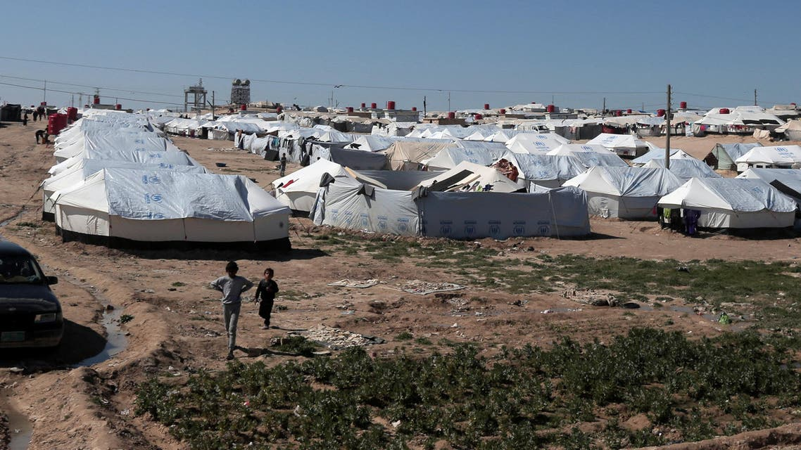 Boys walk at al-Hol displacement camp in Hasaka governorate, Syria March 8, 2019. REUTERS/Issam Abdallah
