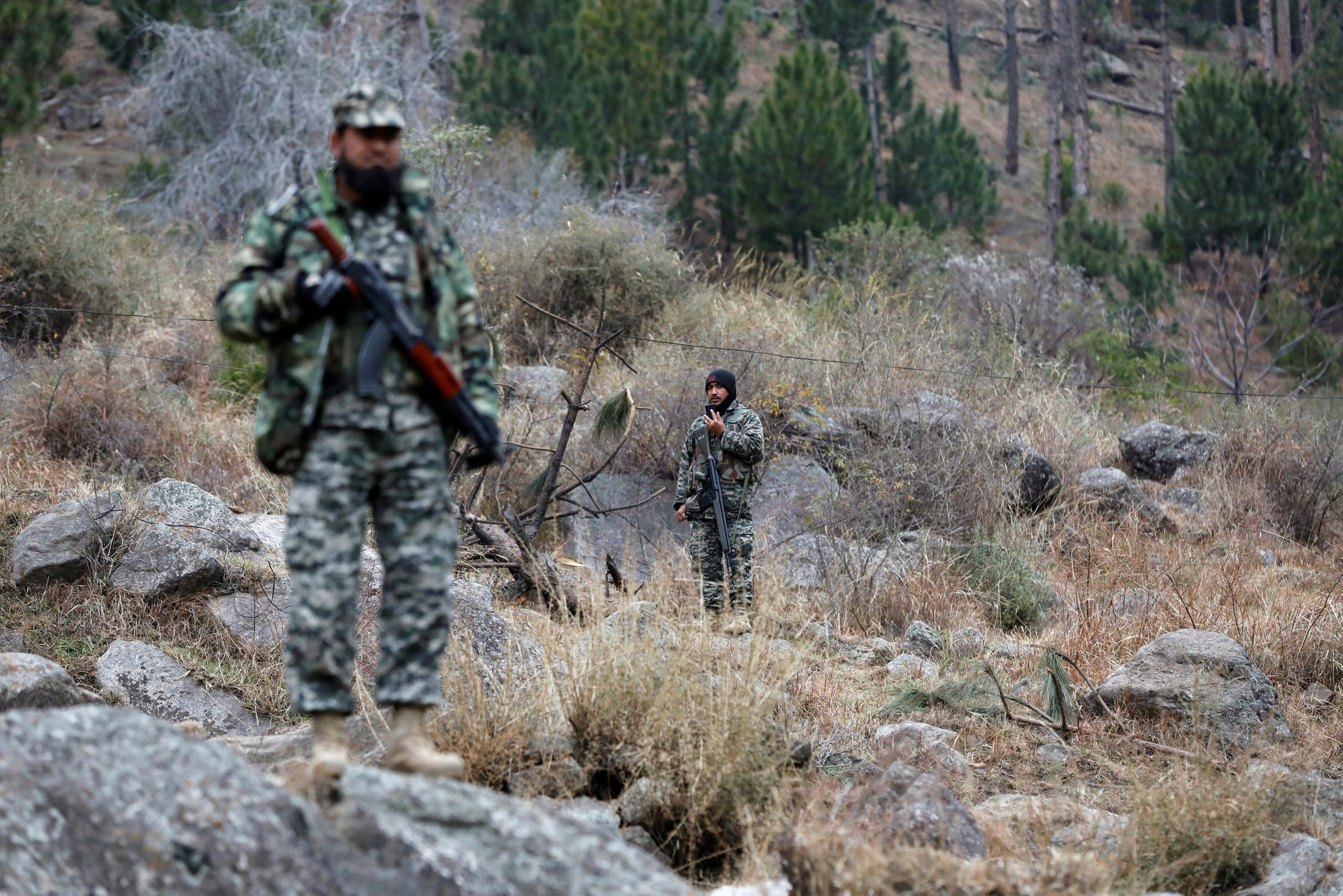 Pakistan's army soldiers guard the area, after Indian military aircrafts struck on February 26, according to Pakistani officials, in Jaba village, near Balakot, Pakistan, on March 7, 2019. (Reuters)