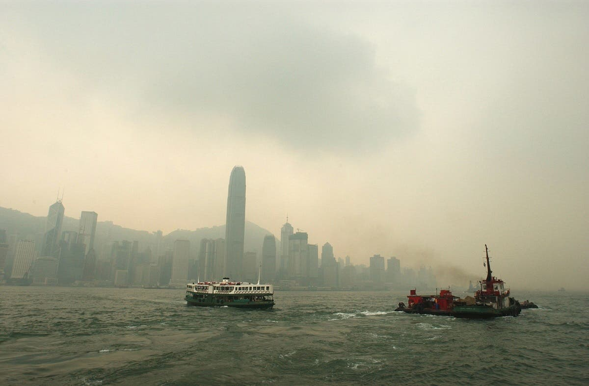 Pollution spoils the view as one of Hong Kong's historic Star Ferries, left, makes its way across Victoria Harbor in thick brownish haze. (AP)