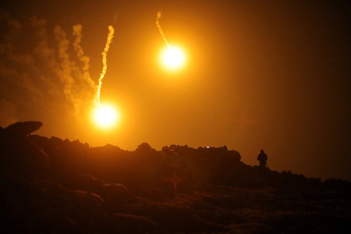 Flares are seen in the sky during fighting in the Islamic State's final enclave, in the village of Baghouz, , Syria, on March 11, 2019. (Reuters)