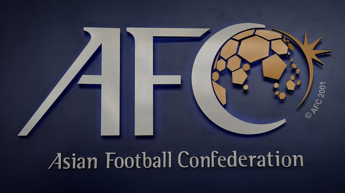 The Asian Football Confederation (AFC) logo is displayed at the AFC headquarters in Kuala Lumpur on March 15, 2017. The upcoming AFC Asian Cup qualifier match between Malaysia and North Korea scheduled for June 8 will take place as planned, the AFC general secretary said on March 15, saying that it is North Korea's responsibility to recommend a neutral venue if diplomatic relations do not thaw. LILLIAN SUWANRUMPHA / AFP