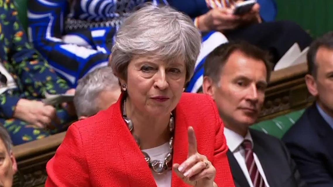 Britain's Prime Minister Theresa May speaking at the start of the debate on the second meaningful vote on the government's Brexit deal. (AFP)