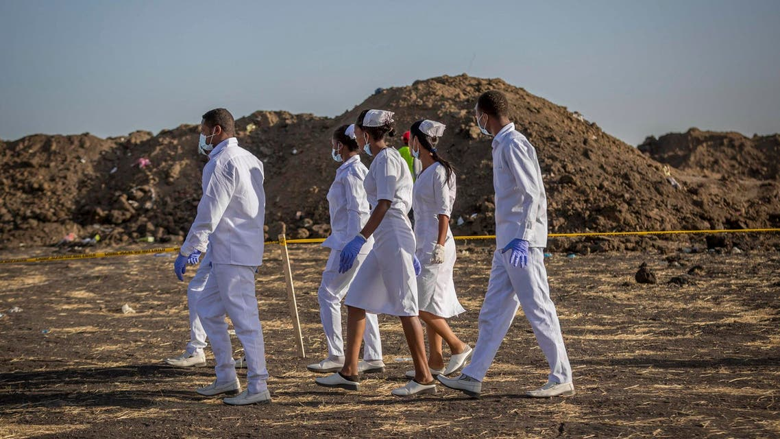 Nurses collect materials at the Ethiopian Airlines crash site on March 12, 2019. (AP)