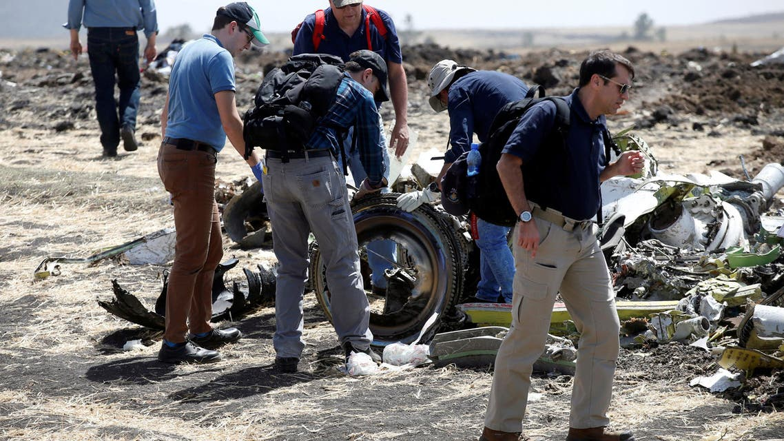 American civil aviation and Boeing investigators search through the debris at the scene of the Ethiopian Airlines Flight ET 302 plane crash, near the town of Bishoftu, southeast of Addis Ababa, Ethiopia March 12, 2019. REUTERS/Baz Ratner