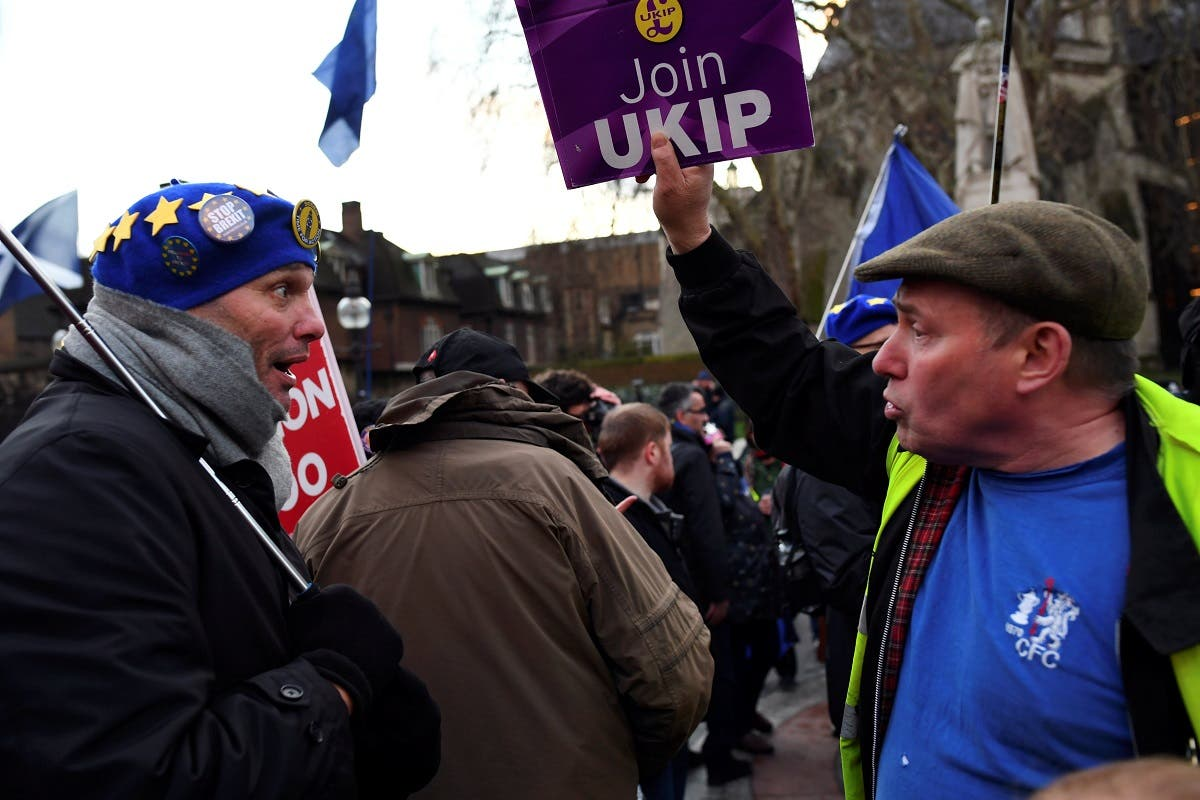 Pro and anti-Brexit supporters argue outside the Parliament in London on March 12, 2019. (Reuters)