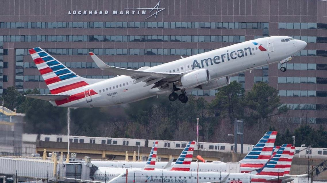A Boeing 737 flown by American Airlines passes by the Lockheed Martin building as it takes off from Ronald Reagan Washington National Airport in Arlington, Virginia. (File photo: AFP)