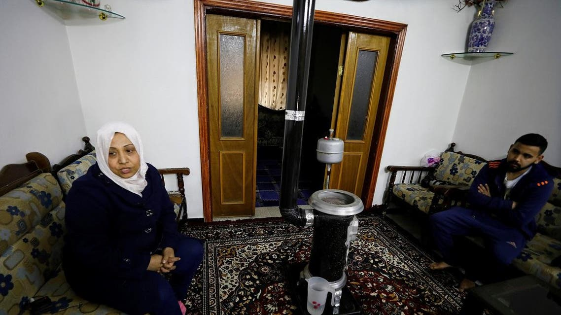 Samiha Fares sits with her son at their house in Ein Terma, a district of eastern Ghouta, Syria. (Reuters)
