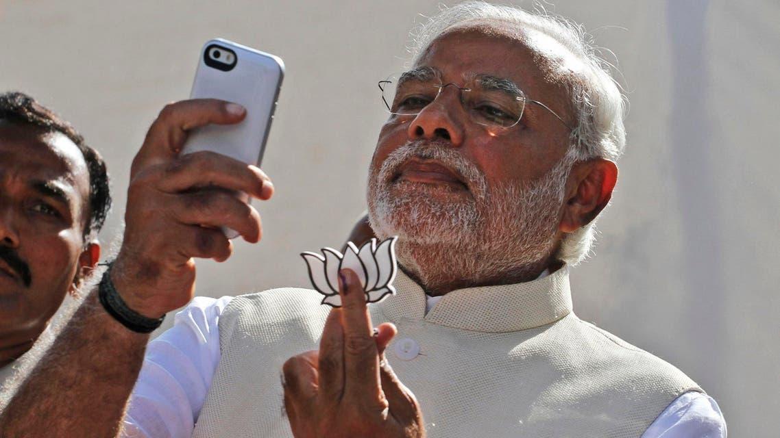 Narendra Modi takes a selfie after casting his vote on April 30, 2014. (File photo: AP)