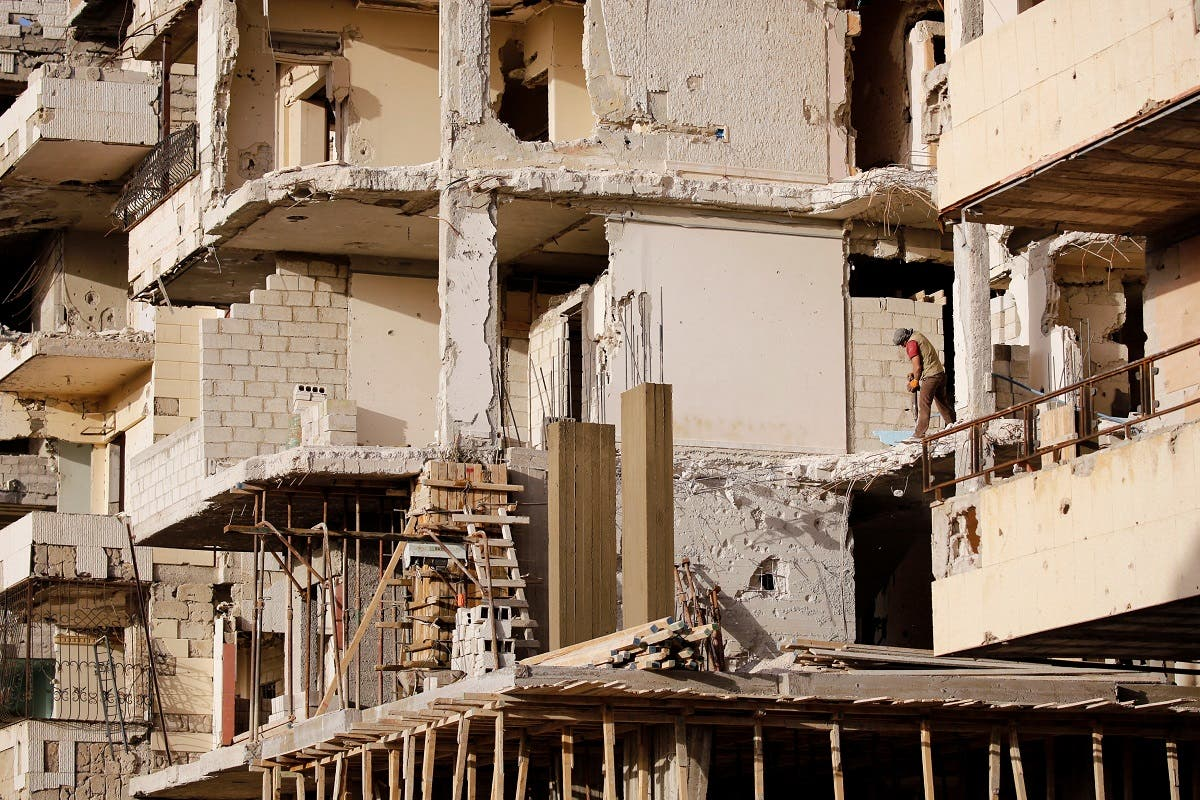 A worker works at a construction site in Ein Terma, a district of eastern Ghouta, Syria. (Reuters)