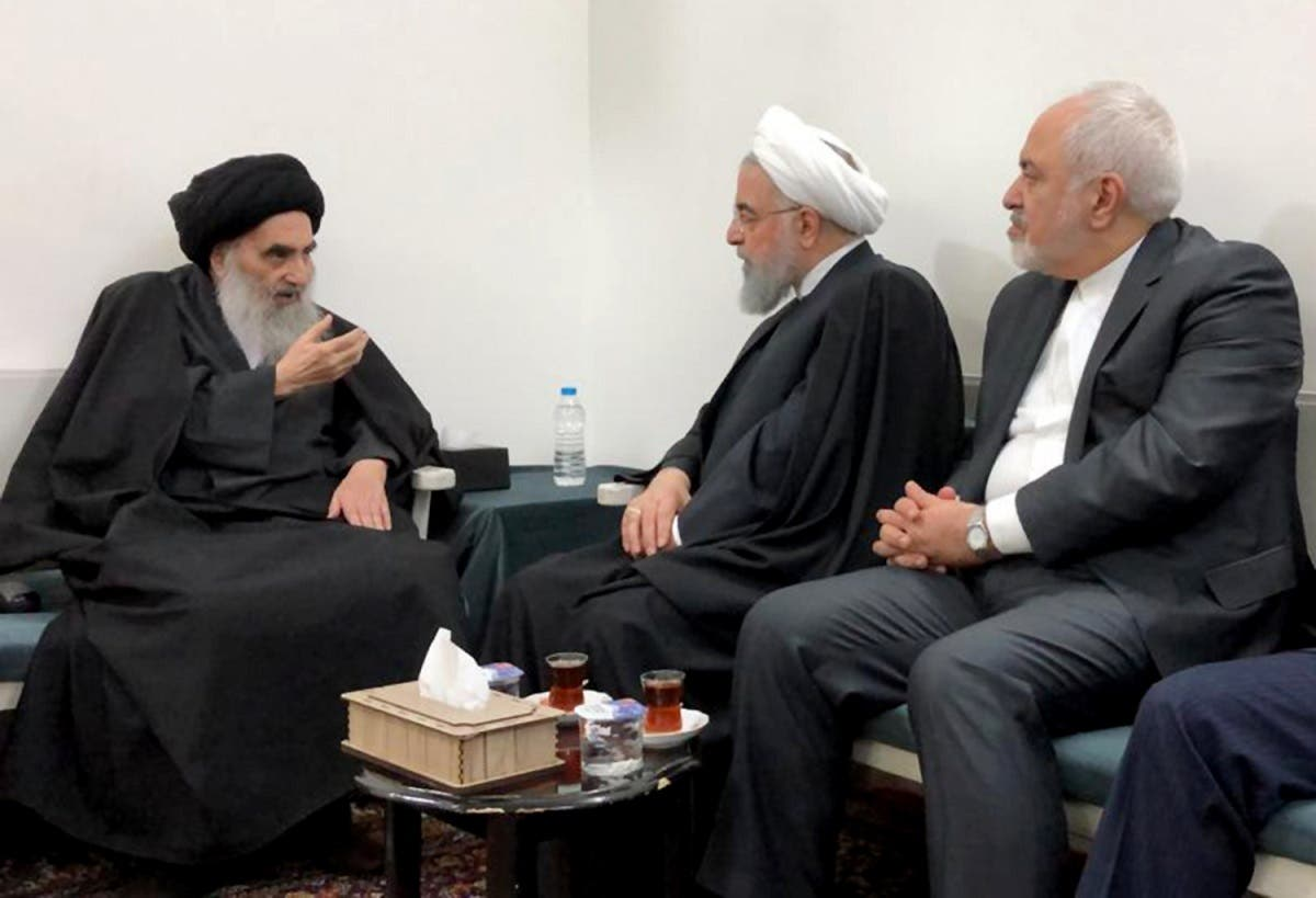 Grand Ayatollah Ali al-Sistani meets with Iranian President Hassan Rouhani (C) and Foreign Minister Mohammad Javad Zarif (R) in the Iraqi central city of Najaf. (AFP)