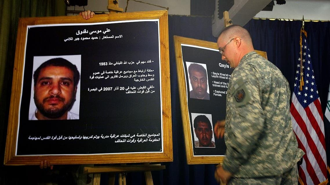 A US solider shows a picture of Ali Mussa Daqduq (L) 02 July 2007 during a press conference at the heavily fortified Green Zone area in Baghdad.US-led forces arrested an Iranian-controlled Lebanese Hezbollah agent in Iraq, where he was training Iraqi extremists. (AFP)