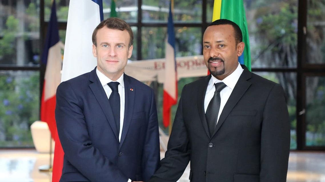 Ethiopian Prime Minister Abiy Ahmed (R) welcomes French President Emmanuel Macron (L) before a meeting in Addis Ababa on March 12, 2019. Ludovic MARIN / POOL / AFP