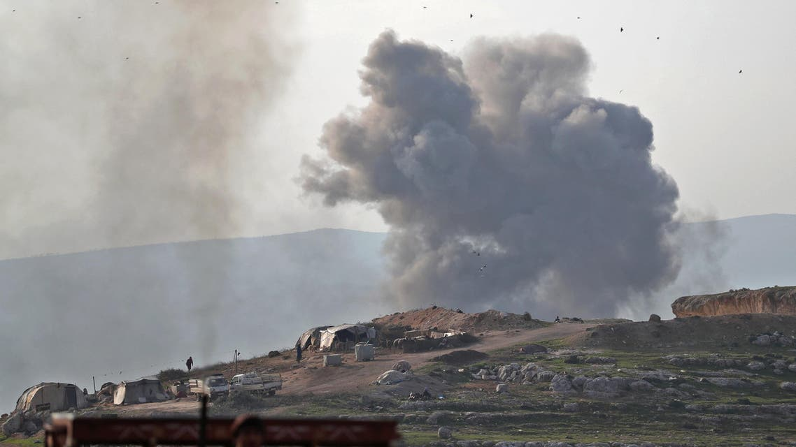 Smoke billows into the sky after reported air strikes on a prison on the western outskirts of Idlib on March 13, 2019. (AFP)