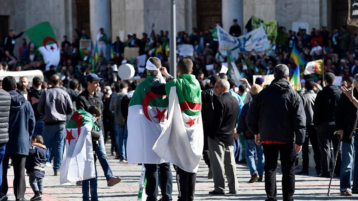Algerians at the first Friday rallies since the president's surprise announcement this week that he would not seek re-election but was canceling April polls, in central Algiers on March 15, 2019.  (AFP)