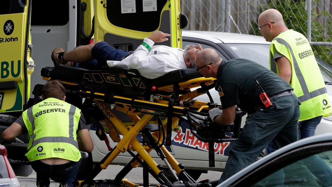 Ambulance staff take a man from outside a mosque in central Christchurch on March 15, 2019. (AP)