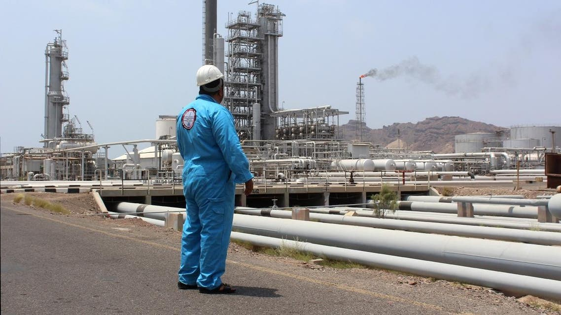 A Yemeni oil worker looks out at the Aden oil refinery after it was re-actived on September 5, 2016. (AFP)