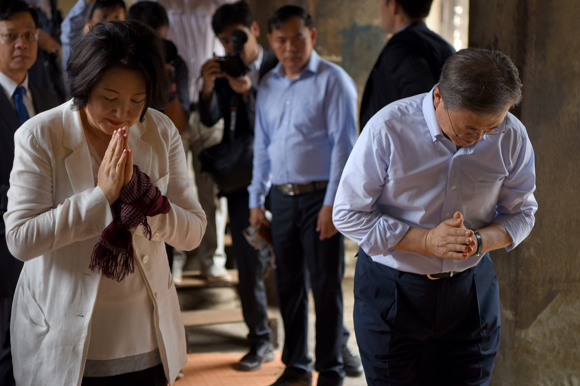 South Korea's President Moon Jae-in and his wife Kim Jung-sook pray during their visit to the Angkor Wat temple in Siem Reap on March 16, 2019. (AFP)