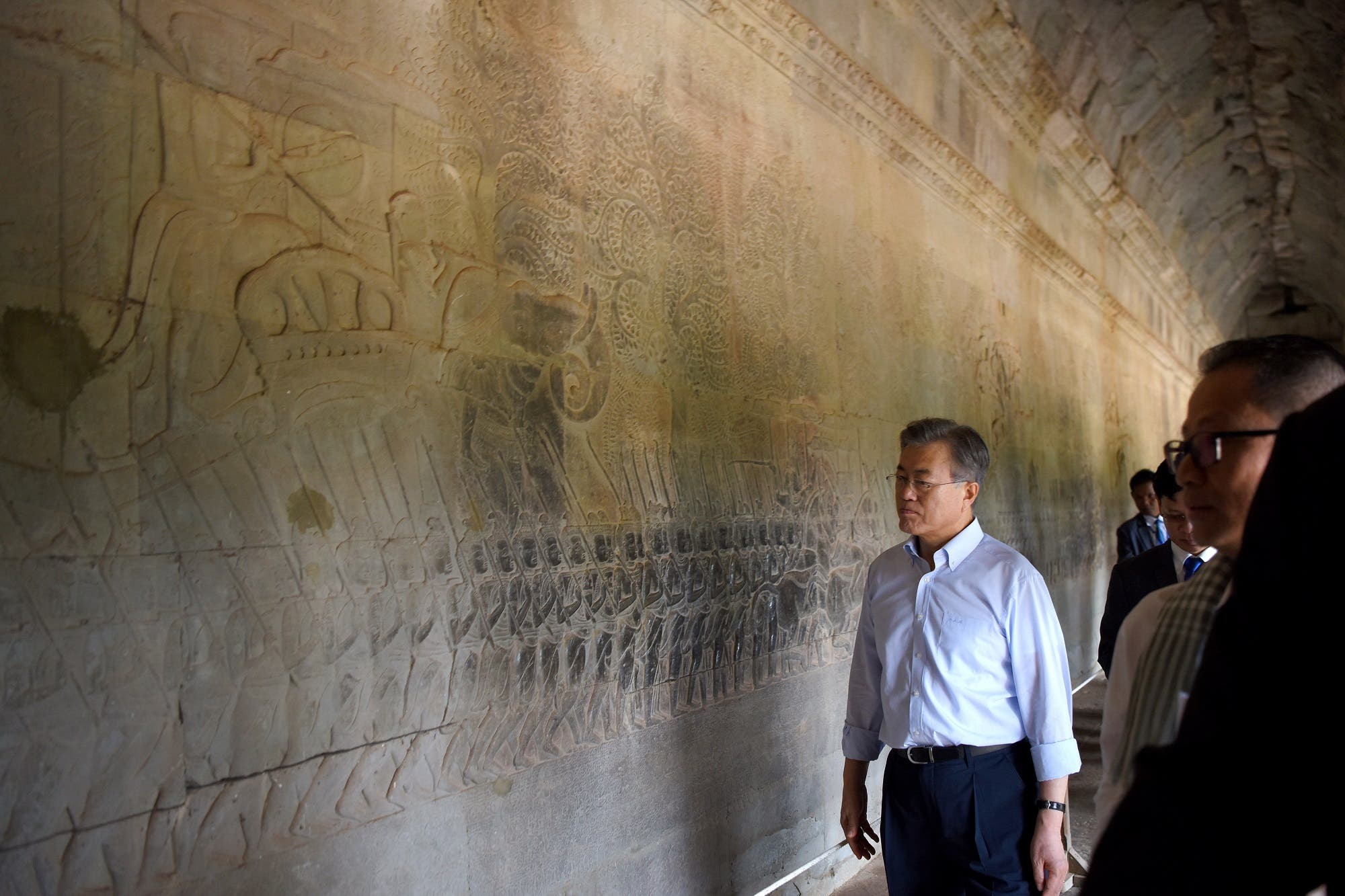 South Korea's President Moon Jae-in looks at a bas-relief on a wall during his visit to the Angkor Wat temple on March 16, 2019. (AFP)