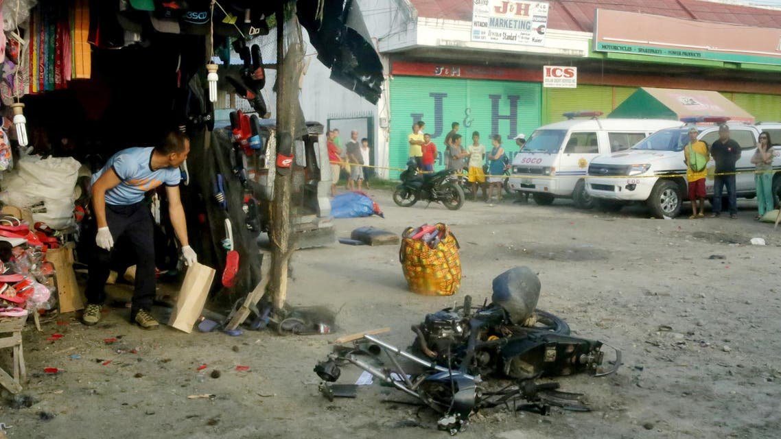 A police investigator gathers evidence at the site of a bomb blast in Isulan town on the southern island of Mindanao. (File photo: AFP)