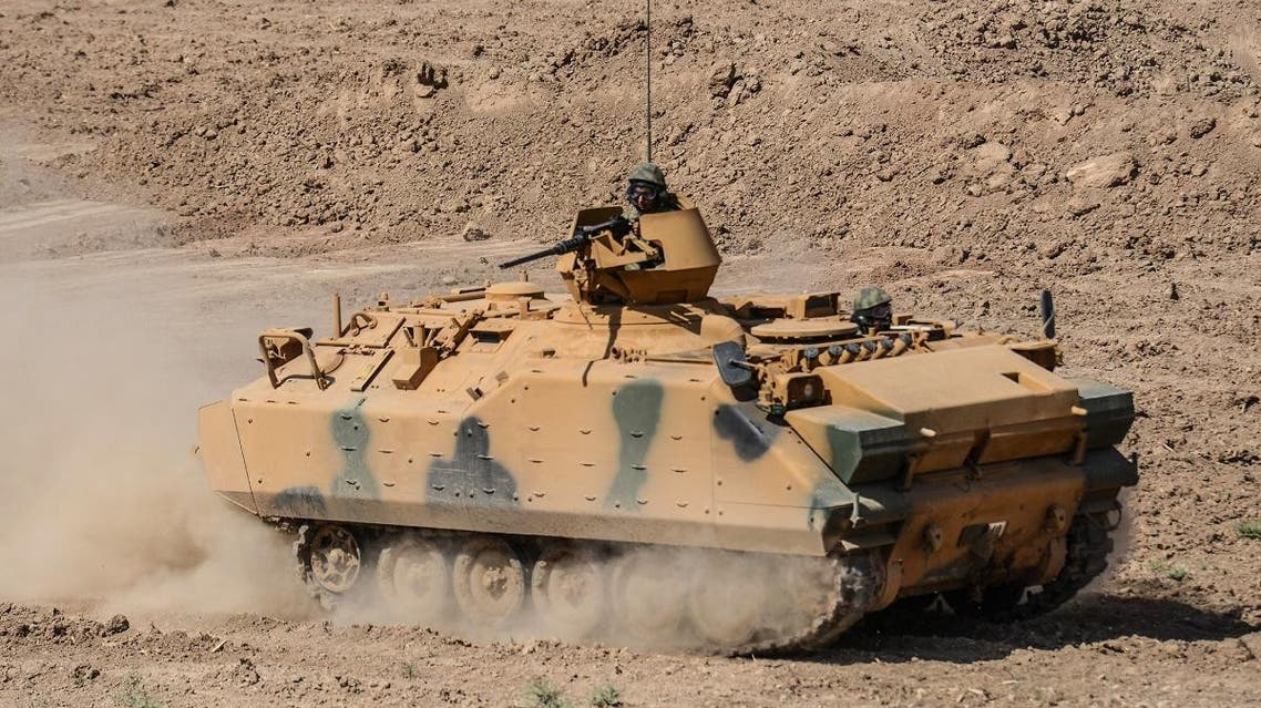 Turkish soldiers conduct military exercises near the Habur crossing gate between Turkey and Iraq. (File photo: AFP)