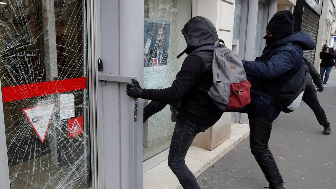 Protesters break a window during a demonstration by the yellow vests movement in Paris, France, March 16, 2019. (Reuters)