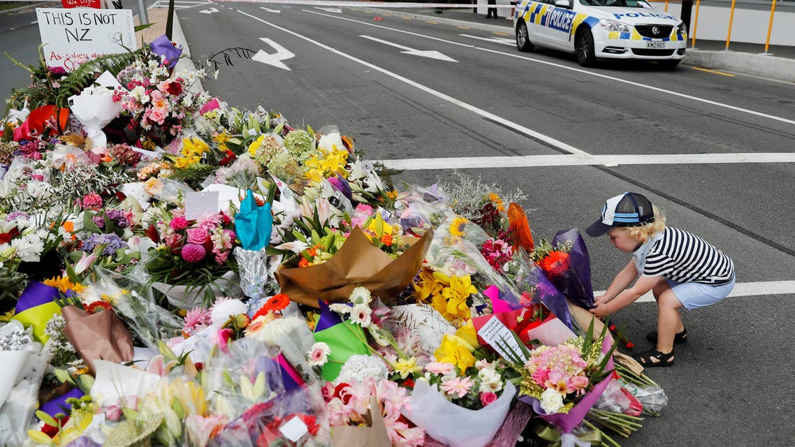 REFILE - CORRECTING BYLINE AND CAPTION Flowers and signs are seen at a memorial as a tribute to victims of the mosque attacks, near a police line outside Masjid Al Noor in Christchurch, New Zealand, March 16, 2019. REUTERS/Jorge Silva
