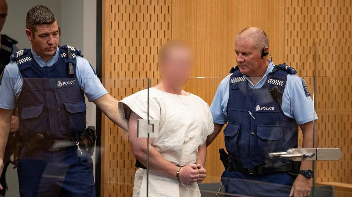 Brenton Tarrant, charged for murder in relation to the mosque attacks, is lead into the dock for his appearance in the Christchurch District Court. (Reuters)